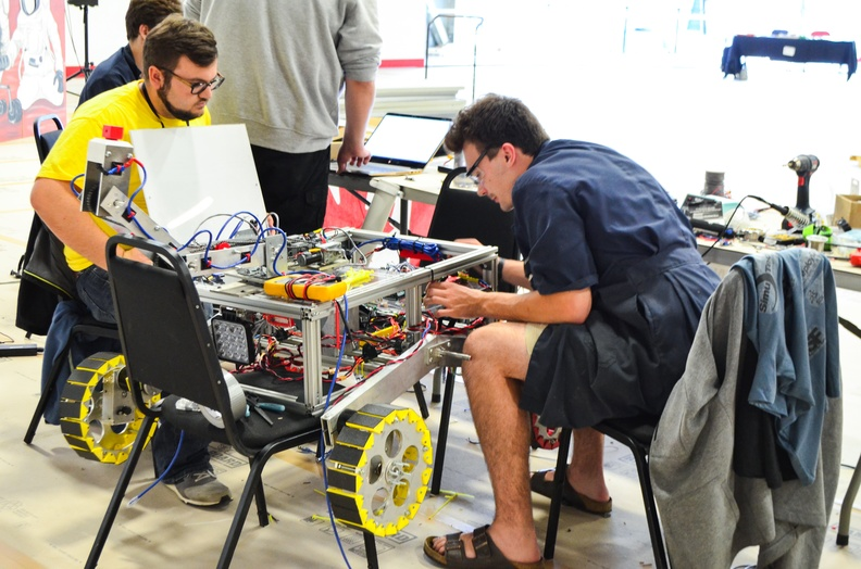 Members working on the rover